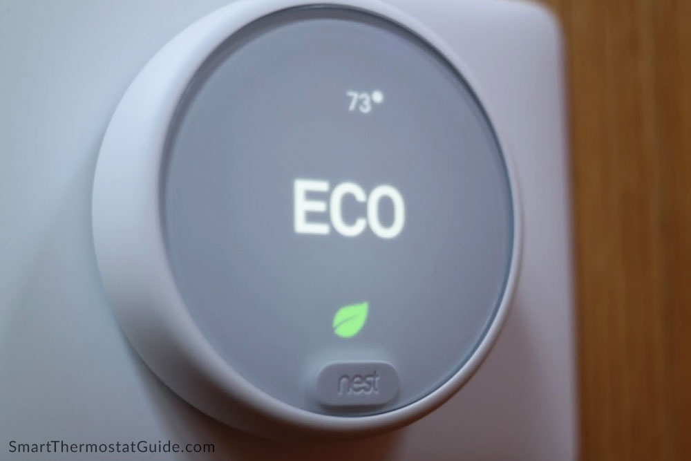 """Photo of the Nest Thermostat E in """"Eco"""" mode."""